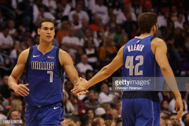 Dwight Powell of the Dallas Mavericks high fives Maximilian Kleber after scoring against the Phoenix Suns during the second half of the NBA game at...