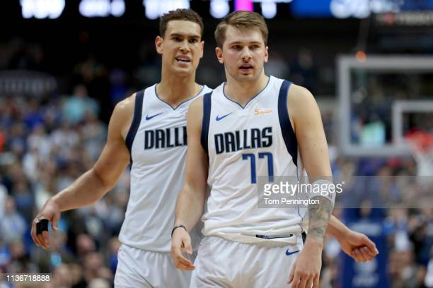 Dwight Powell of the Dallas Mavericks reacts with Luka Doncic of the Dallas Mavericks against the New Orleans Pelicans at American Airlines Center on...