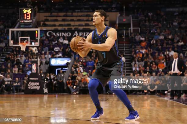 Dwight Powell of the Dallas Mavericks shoots against the Phoenix Suns during the NBA game at Talking Stick Resort Arena on December 13 2018 in...