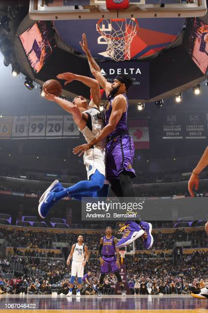 Dwight Powell of the Dallas Mavericks shoots the ball against the Los Angeles Lakers on November 30 2018 at STAPLES Center in Los Angeles California...