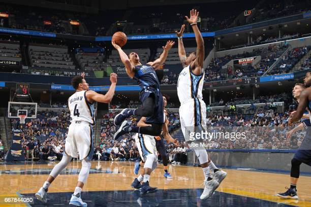 Dwight Powell of the Dallas Mavericks shoots the ball against the Memphis Grizzlies on April 12 2017 at FedEx Forum in Memphis Tennessee NOTE TO USER...
