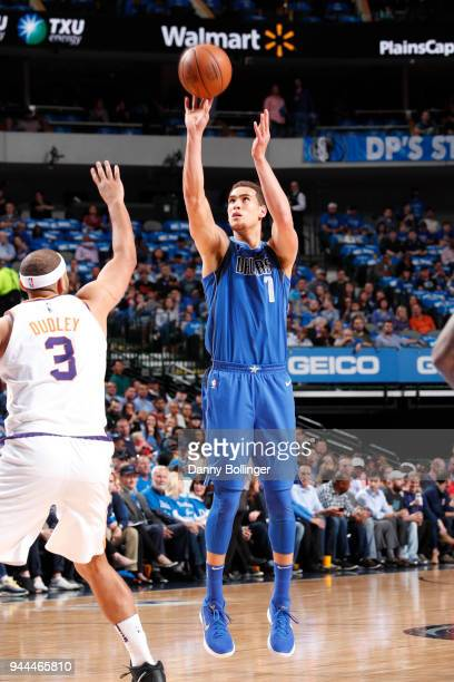 Dwight Powell of the Dallas Mavericks shoots the ball during the game against the Phoenix Suns on April 10 2018 at the American Airlines Center in...