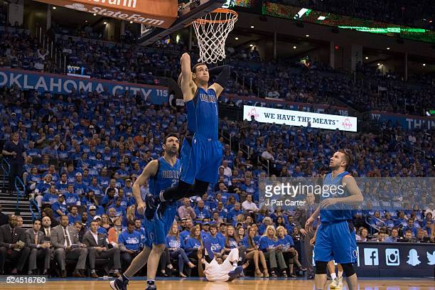 Dwight Powell of the Dallas Mavericks slams two points against the Oklahoma City Thunder during Game Five of the Western Conference Quarterfinals...