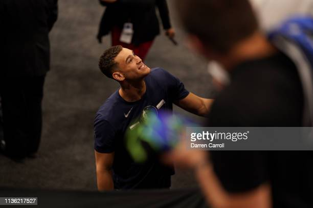 Dwight Powell of the Dallas Mavericks smiles before the game against the San Antonio Spurs on April 10 2019 at the ATT Center in San Antonio Texas...