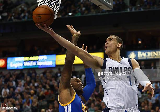 Dwight Powell of the Dallas Mavericks takes a shot against Marreese Speights of the Golden State Warriors at American Airlines Center on December 30...
