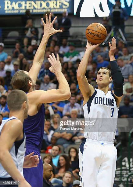 Dwight Powell of the Dallas Mavericks takes a shot against Spencer Hawes of the Charlotte Hornets in the second half at American Airlines Center on...