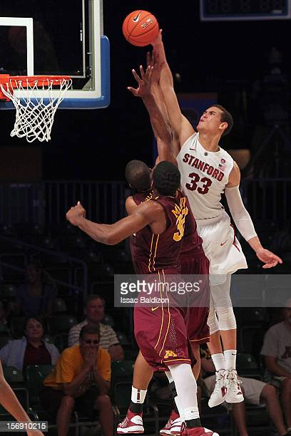 Dwight Powell of the Stanford Cardinal dunks over Rodney Williams of the Minnesota Gophers during the Battle 4 Atlantis tournament at Atlantis Resort...
