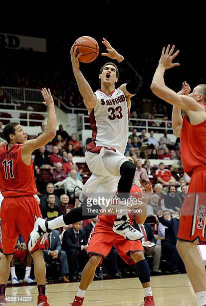 Dwight Powell of the Stanford Cardinal goes in for a layup against the Arizona Wildcats during the first half of their game at Maples Pavilion on...