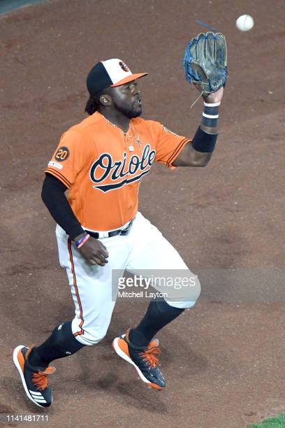 Dwight Smith Jr #35 of the Baltimore Orioles catches a fly ball during a baseball game against the New York Yankees at Oriole Park at Camden Yards on...