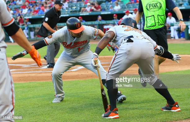 Dwight Smith Jr #35 of the Baltimore Orioles congratulates Trey Mancini for hitting a solo home run in the first inning against the Texas Rangers at...