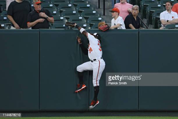 Dwight Smith Jr. #35 of the Baltimore Orioles makes a catch on a hit by Adam Engel of the Chicago White Sox during the second inning at Oriole Park...