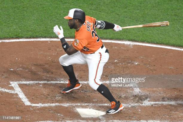 Dwight Smith Jr #35 of the Baltimore Orioles takes a swing during a baseball game against the New York Yankees at Oriole Park at Camden Yards on...