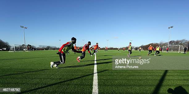Dwight Tiendalli Nathan Dyer and Kyle Naughton running on the pitch during a Swansea City training session at Fairwood training ground on February 4...