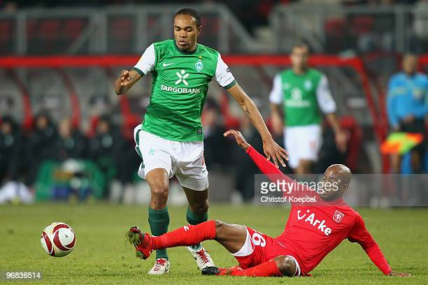 Dwight Tiendalli of Enschede fouls Naldo of Bremen during the UEFA Europa League knock-out round, first leg match between FC Twente Enschede and SV...