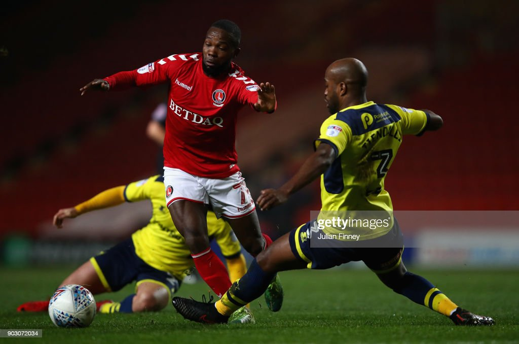 Dwight Tiendalli of Oxford battles with Mark Marshall of Charlton during the EFL Checkatrade Trophy Third Round match between Charlton Athletic and Oxford United at The Valley on January 9, 2018 in London, England.