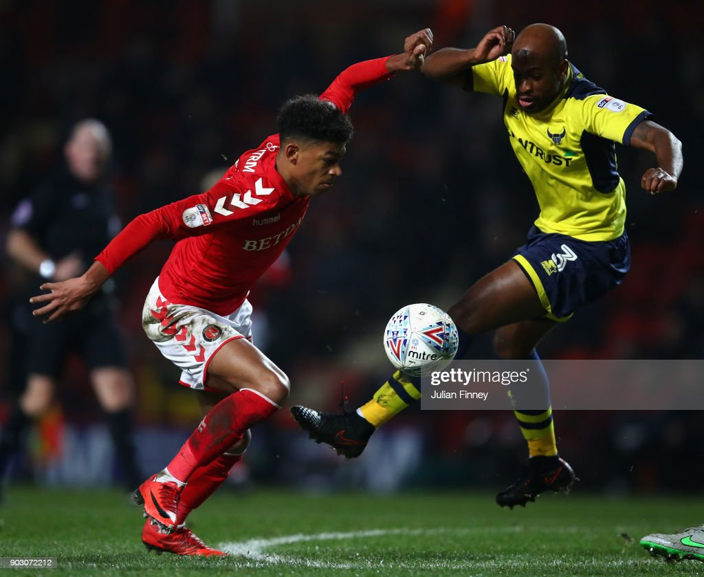 Dwight Tiendalli of Oxford battles with Reeco Hackett-Fairchild of Charlton during the EFL Checkatrade Trophy Third Round match between Charlton Athletic and Oxford United at The Valley on January 9, 2018 in London, England.