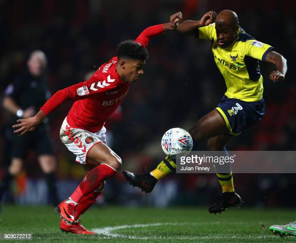 Dwight Tiendalli of Oxford battles with Reeco HackettFairchild of Charlton during the EFL Checkatrade Trophy Third Round match between Charlton...