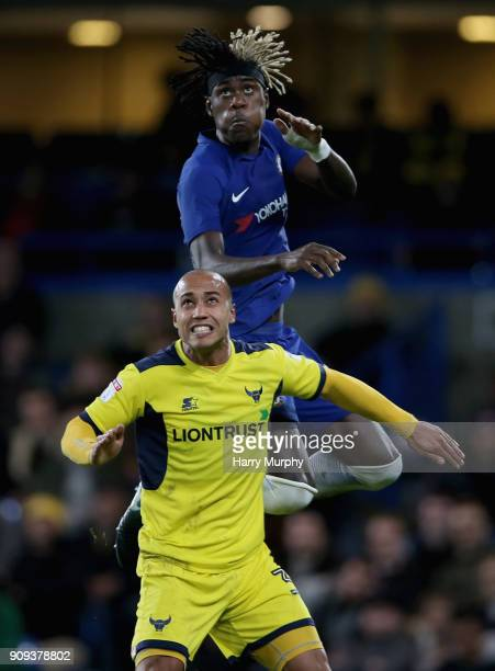Dwight Tiendalli of Oxford United and Trevoh Chalobah of Chelsea jump for the ball during the Checkatrade Trophy quarter final match between Chelsea...