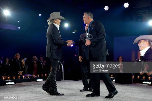 Dwight Yoakam accepts award from BMI Vice President Creative Jody Williams and BMI President/CEO Mike O'Neill during BMI presents Dwight Yoakam with...