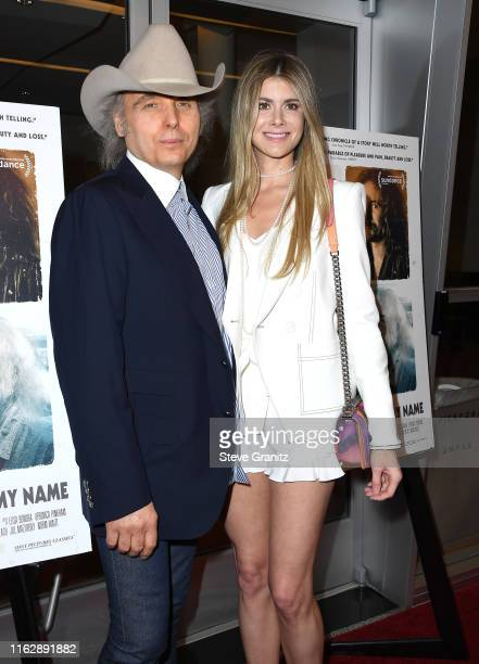 Dwight Yoakam and Emily Joyce arrives at the Premiere Of Sony Pictures Classic's David Crosby Remember My Name at Linwood Dunn Theater on July 18...