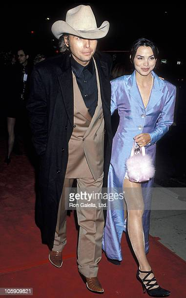 Dwight Yoakam and Karen Duffy during Dumb and Dumber Hollywood Premiere at Cinerama Dome Theater in Hollywood California United States