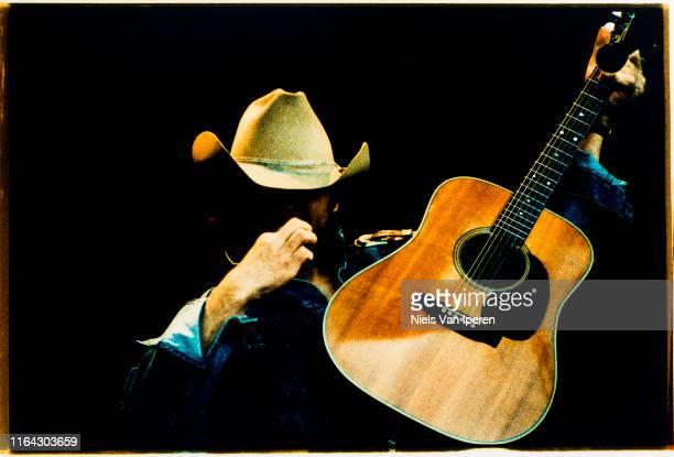Dwight Yoakam, performing on stage, Glastonbury Festival, United Kingdom, 25th June 1994.