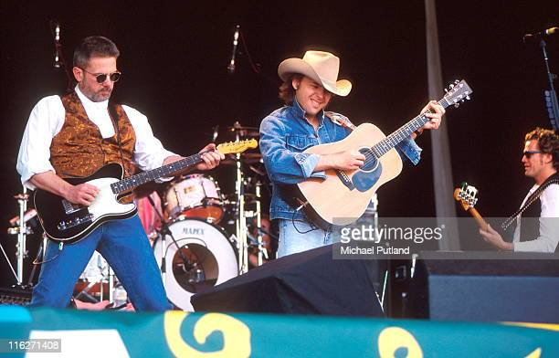 Dwight Yoakam performs on stage at Glastonbury Festival June 1994