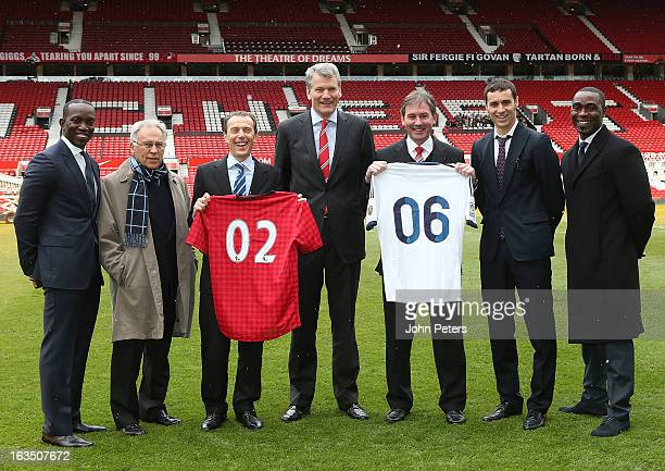 Dwight Yorke, Amancio Amaro, Emilio Butragueno, David Gill, Bryan Robson, Ivan Helguera and Andrew Cole pose ahead of a press conference to announce...