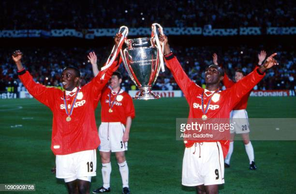 Dwight Yorke and Andy Cole of Manchester United celebrate the victory with the trophy during the UEFA Champions league final match between Manchester...
