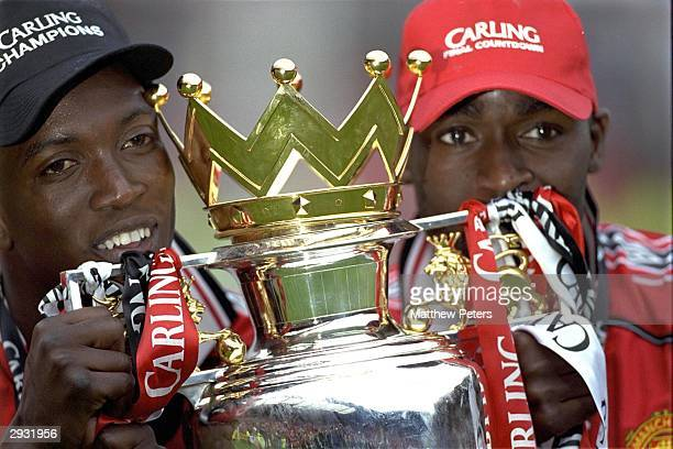 Dwight Yorke and Andy Cole of Manchester United celebrate with the Premiership Trophy after the FA Carling Premiership match between Manchester...