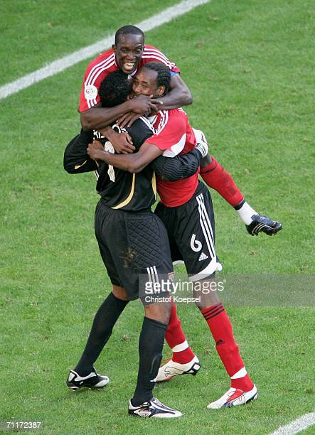 Dwight Yorke and Dennis Lawrence celebrate with goalkeeper Shaka Hislop of Trinidad Tobago after the match ended in a draw at the FIFA World Cup...