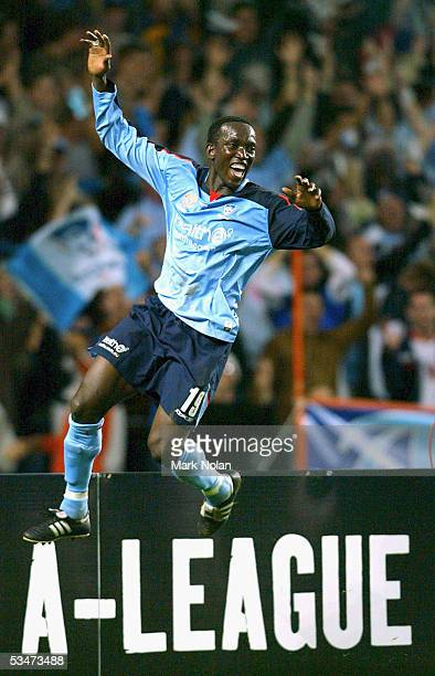 Dwight Yorke celebrates scoring a goal during the round one ALeague match between the Sydney FC and Melbourne Victory at Aussie Stadium on August 28...