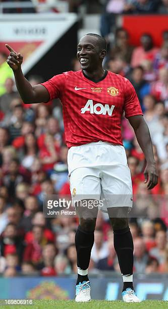 Dwight Yorke greets fans during the Legends match between Manchester United Legends and Real Madrid Legends at Old Trafford on June 2 2013 in...
