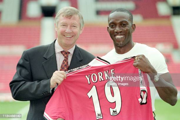 Dwight Yorke is unveiled as a Manchester United player with manager Sir Alex Ferguson at Old Trafford on August 20 1998 in Manchester United Kingdom