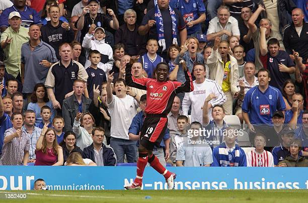 Dwight Yorke of Blackburn celebrates and receives the abuse from the home crowd after scoring during the Barclaycard Premiership match between...