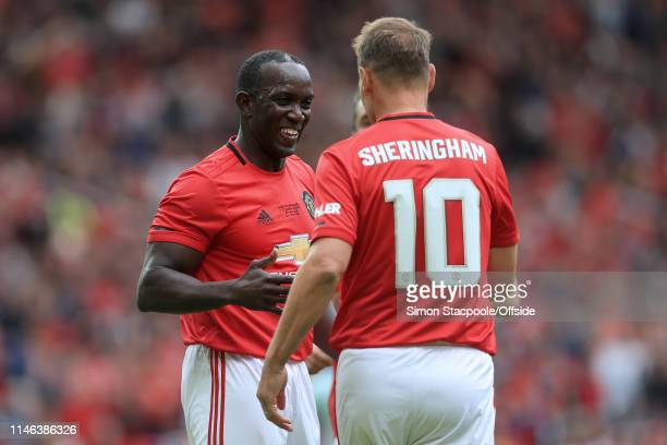 Dwight Yorke of Man Utd and Teddy Sheringham of Man Utd celebrate during the Treble Reunion friendly match between the Manchester United '99 Legends...