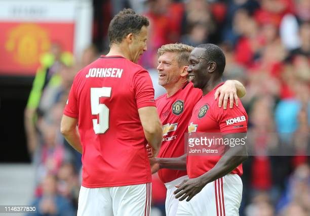 Dwight Yorke of Manchester United '99 Legends celebrates scoring his team's second goal with Ronny Johnsen and Jesper Blomqvist during the 20 Years...