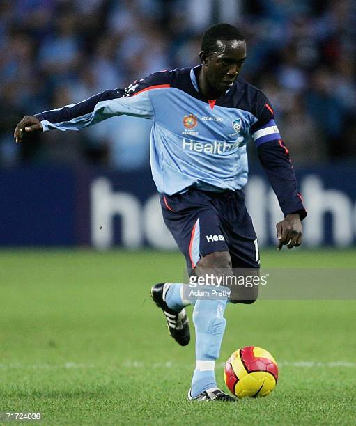Dwight Yorke of Sydney FC controls the ball during the round one A-League match between Sydney FC and the Central Coast Mariners at Aussie Stadium...