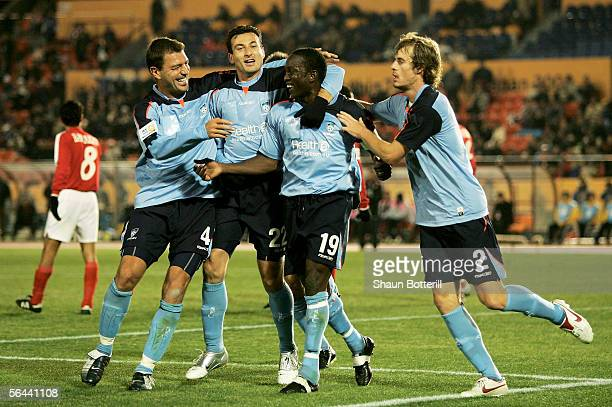Dwight Yorke of Sydney FC is congratulated by teammates Mark Rudan Sasho Petrovski and Iain Fyfe after scoring during the FIFA Club World...