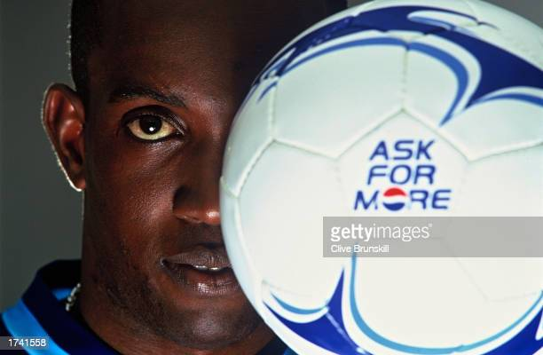 Dwight Yorke of Trinidad and Tobago poses for Pepsi's 'Share The Dream' 2002 advertising campaign in Manchester England on October 15 2001