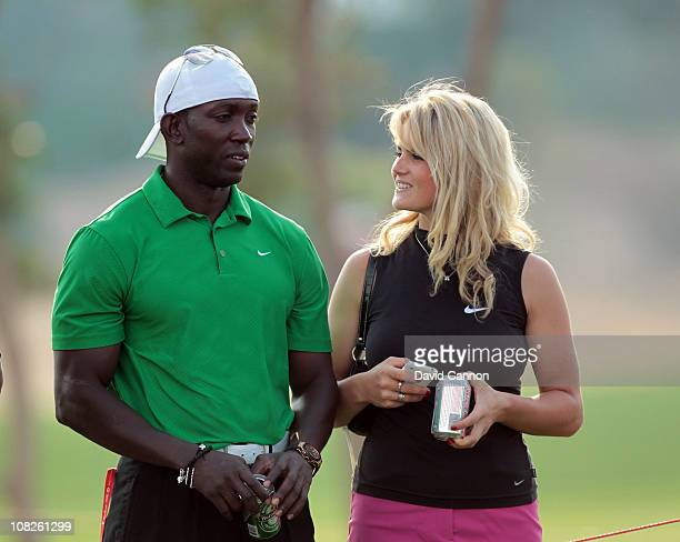 Dwight Yorke of Trinidad and Tobago watching the golf with Carly Booth of Scotland during the third round of the 2011 Abu Dhabi HSBC Golf...