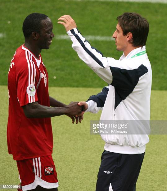 Dwight Yorke Trinidad and Tobago and Gary Neville England embrace at the end of the match
