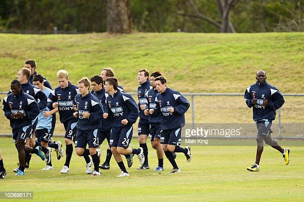 Dwight Yorke warms up behind team mates during a Sydney FC ALeague training session ahead of the Sydney FC v Everton Tour Down Under match on July 10...