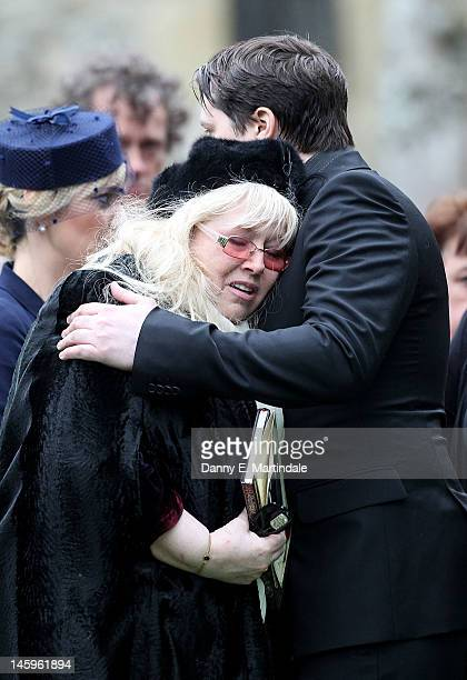 Dwina Murphy Gibb is comforted by her son Robin-John Gibb at the funeral of Robin Gibb held at St. Mary's Church, Thame on June 8, 2012 in Oxford,...