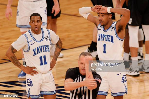 Dwon Odom and Paul Scruggs of the Xavier Musketeers react after fouling the Butler Bulldogs during the second half of their first round game of the...