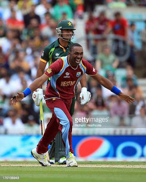 Dwyane Bravo of West Indies celebrates running out Wahab Riaz of Pakistan during the ICC Champions Trophy group B match between West Indies and...