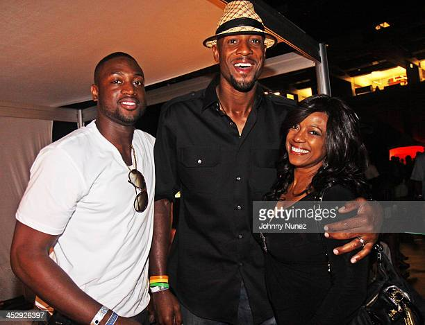 Dwyane Wade Alonzo Mourning and BernNadette Stanis attend the 2009 Essence Music Festival Presented by CocaCola at the Louisiana Superdome on July 4...
