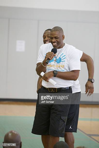Dwyane Wade and Dwyane Wade Sr attend the Dwyane Wade Father Son Mentor Camp part of the Wade's World Weekend on August 25 2011 in Chicago Illinois