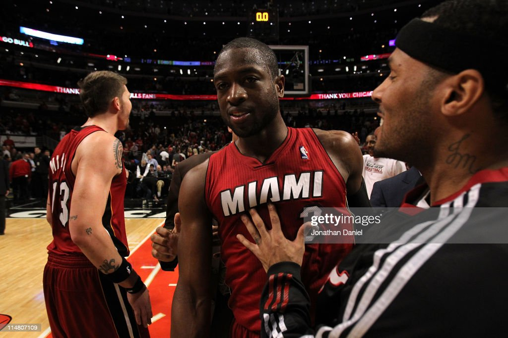 Dwyane Wade #3 and Eddie House #55 of the Miami Heat celebrate after they won 83-30 against the Chicago Bulls in Game Five of the Eastern Conference Finals during the 2011 NBA Playoffs on May 26, 2011 at the United Center in Chicago, Illinois.