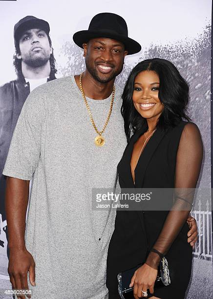 Dwyane Wade and Gabrielle Union attend the premiere of Straight Outta Compton at Microsoft Theater on August 10 2015 in Los Angeles California